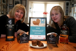 Pat Retson (left) from Highland Park Distillery and Jenna McDill from Argo's Bakery, with the new Highland Park whisky cake and its Scottish Baker of the Year innovation award