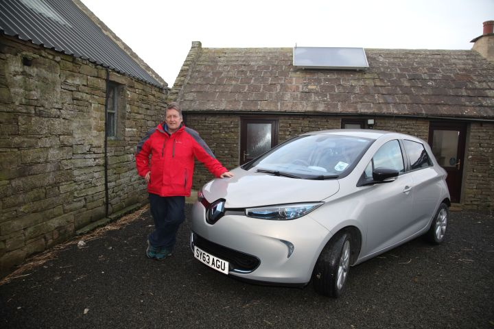 Steve Sankie with his Electric car pic orkney photographic