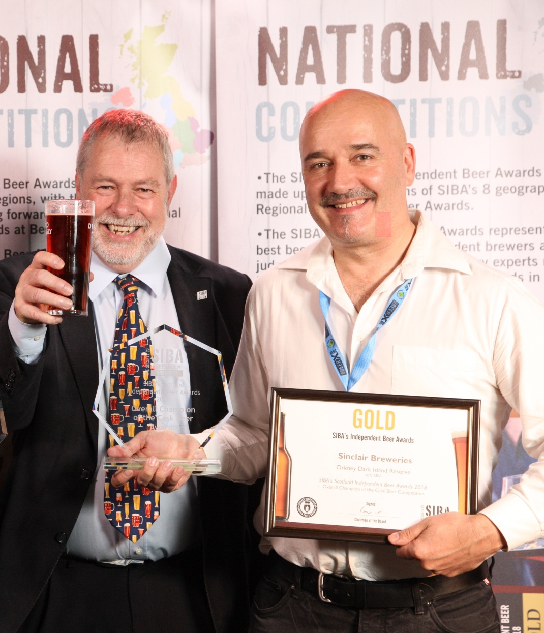 Orkney Brewery's Craig Steven (right) with SIBA's competitions committee chair, Guy Sheppard.jpg