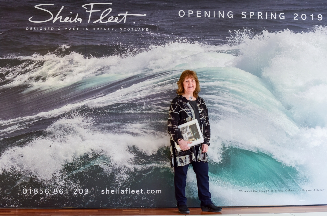 Sheila Fleet pictured outside of her new Princes Square shop, opening 5 April. Image by Julie Howden.