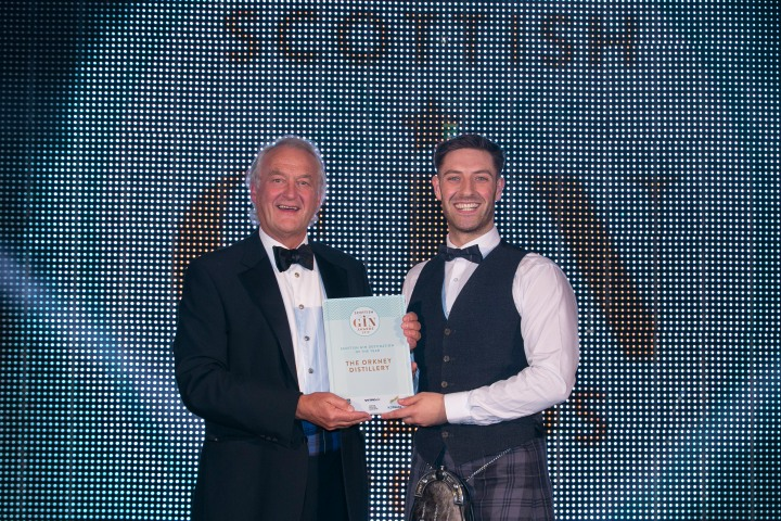 Orkney Distilling's head of production, Louis Wright (r) receiving the Scottish Gin Destination of the Year Award from Alan Wolstenholme, the event's taste and business judge